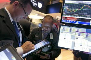 Traders Edward Curran, left, and Robert Arciero work on the floor of the New York Stock Exchange, Friday, Oct. 2, 2015. A weak report on the U.S. jobs market is sending the stock market and the dollar sharply lower in early trading. (AP Photo/Richard Drew)