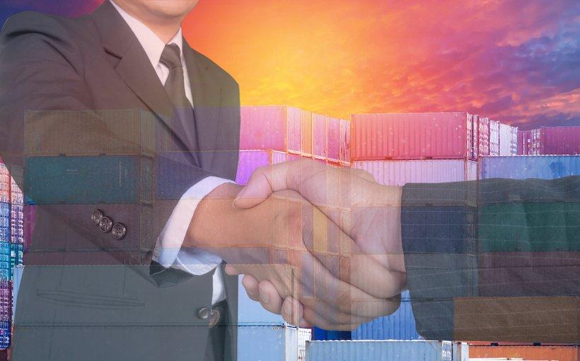 top_workers_handshake_cargo_tradeshutterstock